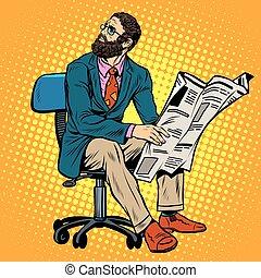 Bearded businessman reading a newspaper