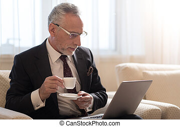 Bearded businessman working with the laptop