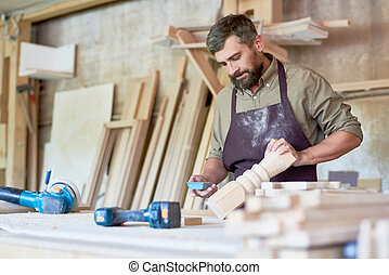 Bearded Carpenter Carving Stair Posts in Workshop - Portrait...