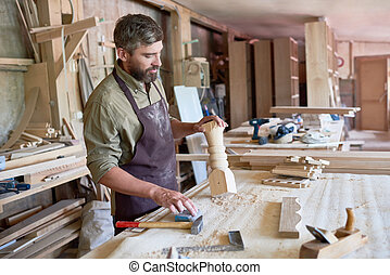 Bearded Carpenter Making Stair Posts in Shop - Portrait of...