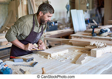 Bearded Carpenter Working with Wood in Shop - Portrait of...