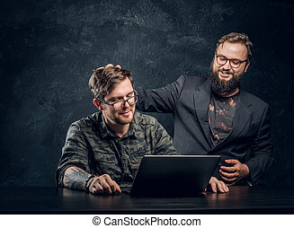 Bearded customer put his hand on the head of the hacker