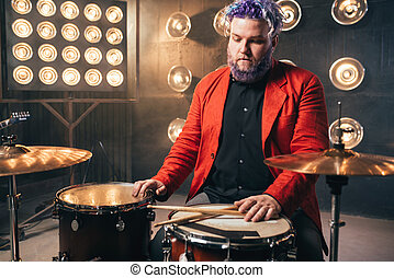 Bearded drummer in red suit, vintage style