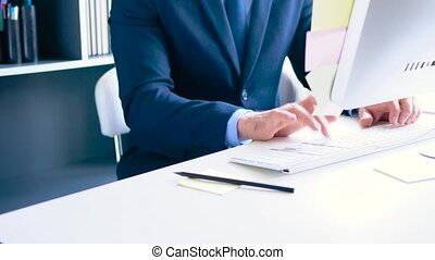 Bearded formal dressed businessman working in the office