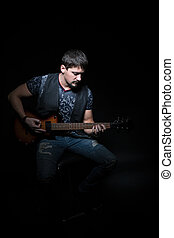 Bearded guitarist with an electric guitar