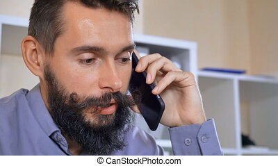bearded guy calling by mobile