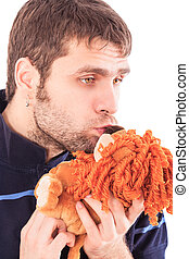 Bearded Guy Holds in Hands Kisses Soft Animal Toy