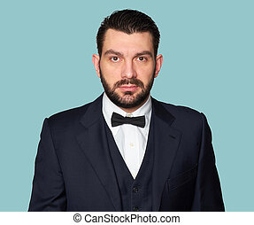 bearded handsome man looking at camera