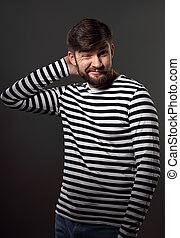 Bearded happy emotional man thininking and scratching the...