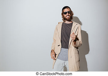 Bearded hipster cheerful man dancing.