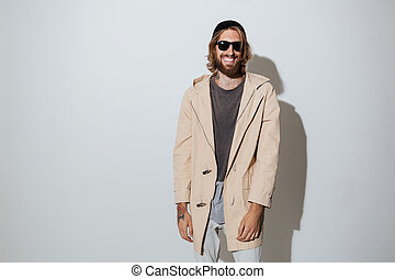 Bearded hipster happy man wearing sunglasses