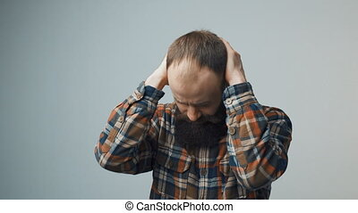 hipster man suffering from headache - Bearded hipster man...