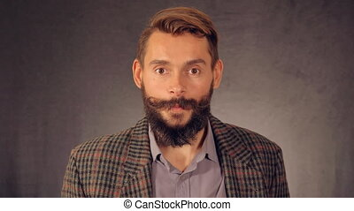 bearded hipster shows sign thumbs up