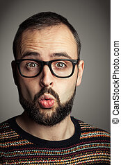 Bearded hiptser - Surprised bearded hipster with black...