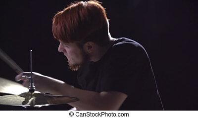 Bearded Instrumentalist - Tilt down of drummerboy going wild...