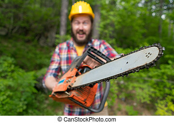bearded lumberjack with a chainsaw makes faces
