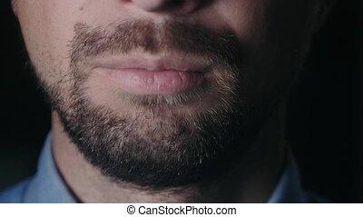 Bearded man a blue shirt
