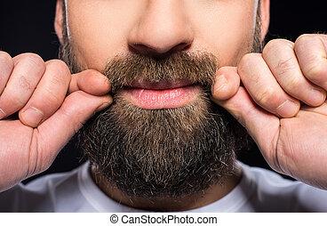 Bearded man - Beard man. Close-up cropped image of bearded...