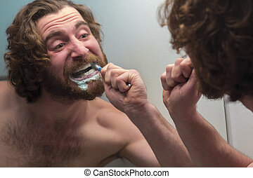 Bearded Man Brushing Teeth