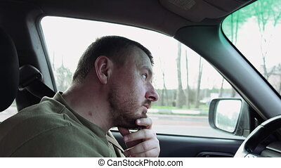Bearded man driver waits for the green light