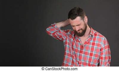 Bearded man expresses bother - Young caucasian man...
