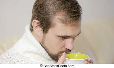 Bearded Man Having a Cup of Tea a sweater
