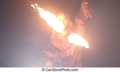 bearded man in fire performance