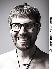bearded man in glasses plays the fool. crazy man, funny expression