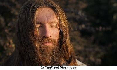 Bearded Man in Meditation - Yogi sitting in meditation on...