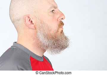 bearded man in profile on white background