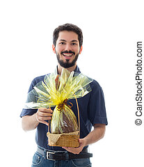 Bearded man is holding an easter egg in his hands.