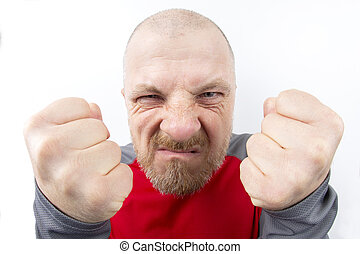 Bearded man of menacing look with clenched fists closeup on white background