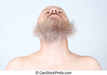 bearded man on a light background