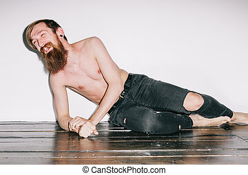 Bearded man on the floor