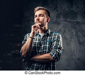 Bearded man over grey background. - Studio portrait of...