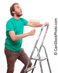Bearded man painting on a ladder
