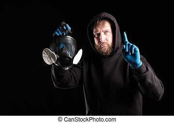bearded man raised his index finger up calls to put on a mask
