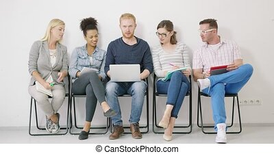 Bearded man showing ideas on laptop - Group of colleagues in...