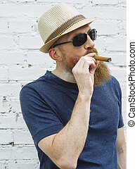 Bearded man smoking a cigar