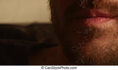 Bearded man smoking electronic cigarette. Vaper. Smoke generated by the cigarette. Concept of smoker of the future, care with health or diseases caused by electronic cigarettes