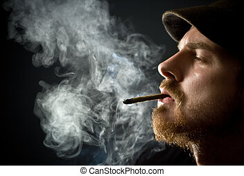 Bearded man smoking - Fine art portrait of masculine guy...