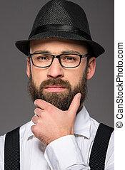 Bearded man - Bearded hipster man wearing hat , suspenders,...