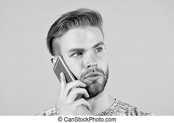 Bearded man talk on mobile phone. Macho use smartphone. Guy with mobile device. Digital marketing, buy online and cyber monday concept. New technology for communication and modern life.
