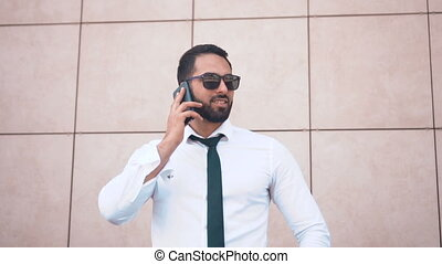 Bearded Man Talking by Phone