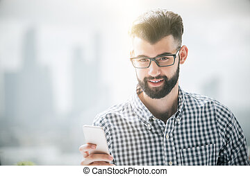 Bearded man using cellphone