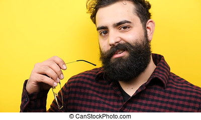 Bearded man winking silly to the camera