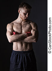 Bearded man with boxing bandages