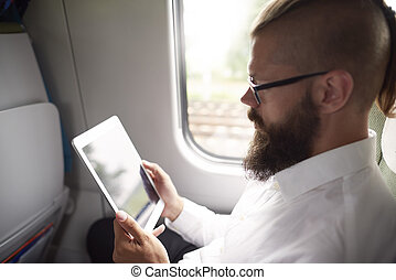 Bearded man with digital tablet