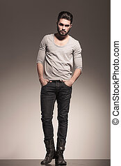 bearded man with hands in his pockets - young bearded man...