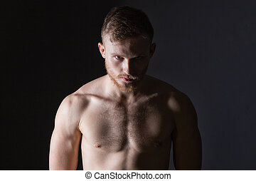 Bearded man with muscular body